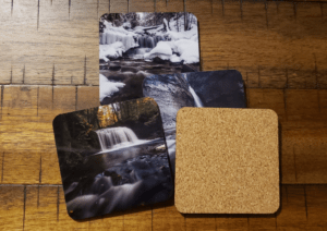 The coasters have a cork backing for extra grip.